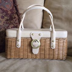 MAXX NEW YORK HANDBAG Adorable natural color leather and wicker bottom handbag.  Magnetic closure.  This bag is used but in great condition.  There are a couple of very small stains inside ( lipstick)  Maxx New York Bags