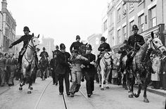 A demonstrator is taken away under arrest by police officers after a mounted baton charge, in East London, on Oct. to stop fighting between anti-fascists and Sir Oswald Mosley's blackshirts. Diesel Punk, Vintage London, Old London, London Boroughs, East End London, London History, Old Street, Historical Images