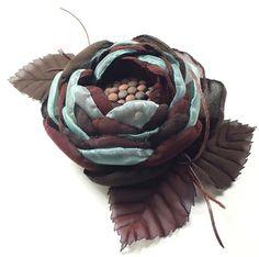 Спящий цветок. Брошь-цветок из ткани.. Брошь-цветок ручной работы из ткани. Бирюзовый, коричневый, шоколадный цвета. Серединка - холодный фарфор. Металл цвета меди. Довольно спокойные оттенки.