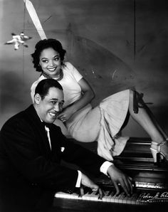 "Dancer and actress Louise Franklin strikes a pose with Duke Ellington for on the set of his musical, ""Jump For Joy,"" 1941. Source: John Reed, Herald Examiner Collection, Los Angeles Public Library."