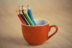 Color pencils on table by Pushish Images on @creativemarket