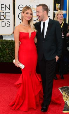 Aaron Paul's wife Lauren Parsekian steals the show in this wonderful red dress, worn to the Golden Globes 2014.