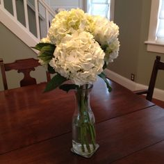 Surprising wedding inspiration from white hydrangeas in a wine carafe on my dining room table Wedding Reception, Our Wedding, Wedding Venues, Wedding Tables, Buffet Table Settings, Wine Carafe, White Hydrangeas, Surprise Wedding, Vintage Display