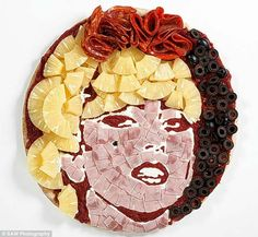 Lady Gaga Pizza Portrait. This is one way to barf up a perfectly alright pizza.
