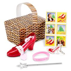 Wonderful Wizard of Oz Party Favor Box - Box includes a Wonderful Wizard of Oz sticker sheet, plus ruby lip gloss key chain, (1) asst Theres No Place Like Home bracelet, a mini silver star wand, and a candy filled ruby shoe. Please Note: One or more of the party favors included in this favor kit may be substituted with an item of similar quality due to availability.