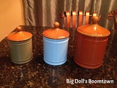 spray paint canisters and glaze with water and little acrylic craft paint