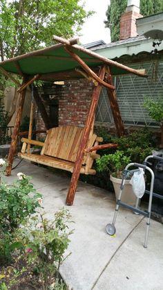 A non prefab log swing created and designed by Kyle Flinn