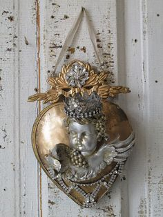 Ornate heart wall hanging w/ cherub gold painted metal embellished w/ rhinestone French Santos locket style home decor anita spero design Heart Mirror, Heart Wall, Gold Paint, Metallic Paint, Heart With Wings, Grey And Gold, Assemblage Art, Angel Art, French Country Decorating