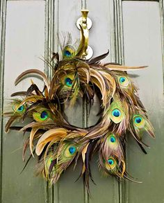 Southern Living an Elegant Centerpiece or wreath just as beautiful indoors and a different take on your traditional wreath. If your using feathers incorporate them in your garland and throughout your other decorations, it pulls everything together and gives you a professional look.