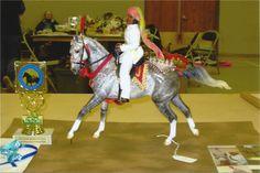 SWF Sundara, trad scale OS Marwari stallion by Carissa Kirksey, tack by Carissa Kirksey, CM doll by Carissa Kirksey & P. Kirksey. Sundara resins are available. Over All Performance Champion, New Years Bash Live 2014.