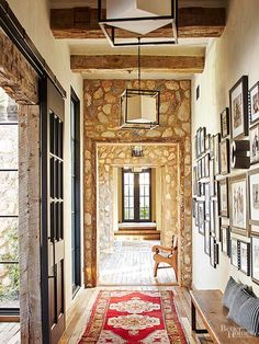Even the hallways match the homeowners' vintage-meets-industrial style. Classic stone doorways contrast a trendy gallery wall.