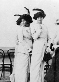 Grand Duchess Maria and Tatiana Nikolaevna Romanova with Olga behind them at Krasnoe-Selo in 1913.A♥W