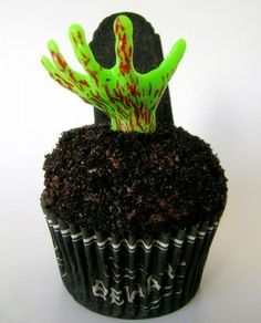 An easy way to make awesome Halloween cupcakes! Zombie Hand Cupcake Topper #cupcakes #halloween #cupcaketopper