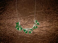 Resin and wire Triple Four Leaf Clover- $15.  Hand made. Contact Bojosmoms Creations on Facebook.