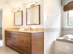 Natural Glow - Natural Glow This modern bathroom's custom walnut vanity features a lighted honey onyx countertop designed to enhance the beauty of the stone's natural properties and to create an ambient glow. Design by Nancy Mikulich Bathroom Vanity Designs, Bathroom Sink Vanity, Bathroom Pictures, Bathroom Design Small, Bathroom Ideas, Mirror Vanity, Vanity Cabinet, Bathroom Mirror Lights, Bathroom Lighting