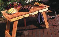 Grill Table  It's a handy companion for your barbecue—and folds up for easy storage.