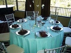 Turquoise Table Cloth with Simplistic Silver Cane Chairs with Touches of Black Accents
