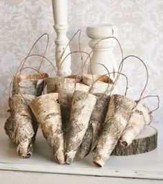 Mandy this reminds me of your Christmas decorations this last season.  Lovely.   birch bark cones for pew decorations or for on a christmas tree.  Lovely