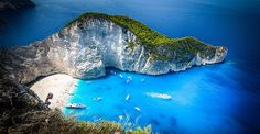 Navagio Bay, Greece.  Ok Greece behave yourself now stop tempting me with all this beauty...You know i cant get there right this minute and looking at this is NOT helping!
