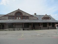 Check out what the H. Richardson built train station in Palmer, Ma looked like before the folks at The Steaming Tender fixed it up. Really makes you appreciate the work they did! Louis Sullivan, Old Train Station, Filming Locations, New England, Trains, Cabin, Architecture, House Styles, Building