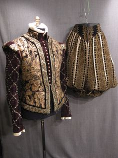 renaissance, elizabethan, pants, renaissance, men, w37, black, paned, breeches, gold, and, pink, embossing, on, panes, trimmed, with, gold, lame, brown, velvet, pants, under, panes, v, shaped, waistband, good, velvet - OSF Costume Rentals