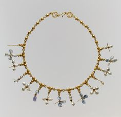Necklace with Pendant Crosses. Date: 6th–7th century. Geography: Made in probably Constantinople. Culture: Byzantine. Medium: Gold, pearl sapphire, smokey quartz, quartz.