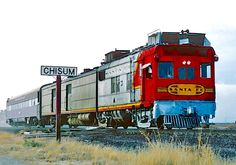 "Santa Fe's articulated doodlebug M190 and one coach were running 75 mph when they zipped by the Chisum, N.M. station sign. Train 25 was called the ""Pecos Valley Chief."""