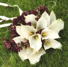 White bouquet with a splash of deep plum to go with the possible bridesmaid dresses