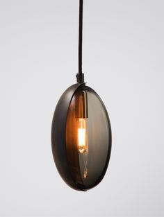 Our classic Oona Pendant, now in a second, smaller size. Individually crafted from blown glass and hand-formed brass with a blackened patina.