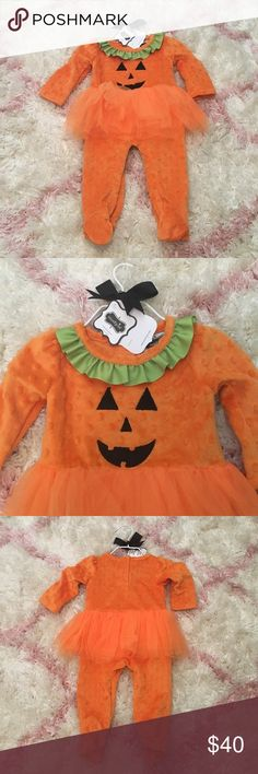 Mudpie 0-6mo Halloween outfit Adorable outfit for infant Halloween! Oranges dotted mainly fleece onesie with footies. Black jack-o-lantern face on chest with green grosgrain ribbon trim at neck, with orange tulle tutu at waist. Back snaps for ease of wear. New with tags - brand new, never worn. Still comes on original hangar and gift tag! Mudpie One Pieces Footies