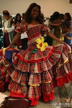Jamaica National Costume.  I need to educate my girls and myself on my Jamaican history. As a child , I had a doll dressed up like this - part of the nationalist fever of the early 60s. Jamaica - one people - one love.