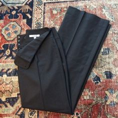 """Last chance! Nordstrom Wool Suiting Trousers Only wore once to an interview! Lightweight black slacks with flattering flat front, thick banded waist, and zip/3 hook closure. Slim fit through hips then gently A-lines into wider legs. By Nordstrom office line """"classiques entier"""" 96% wool 4% Lycra Nordstrom """"Classiques"""" Pants Trousers"""