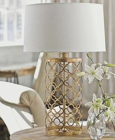 gold lamp with a crisp, classic white shade. I would love a matching pair of lamps for bedroom.  Need to match gold mirror and coral accent pillow.  I like gold/brass or mint/aqua I like taller size with drum shade