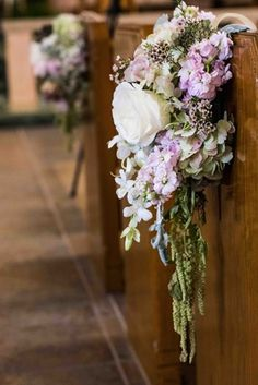 Church Pew Arrangement    Photography: Images by Berit, Inc.   Read More:  http://www.insideweddings.com/weddings/east-coast-countryside-wedding-with-vintage-details/521/