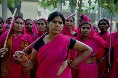"""The Gulabi Gang was formed 2006 by Sampat Pal Devi in Northern India. This region is one of the poorest districts in the country & is marked by a deeply patriarchal culture, rigid caste divisions, female illiteracy, domestic violence, child labour, child marraiges & dowry demands. The group is known as Gulabi or 'Pink' Gang because the members wear bright pink saris & wield bamboo sticks. Sampat says, """"We are not a gang in the usual sense of the term, we are a gang for justice."""""""