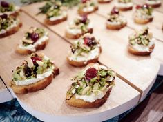 Colors of the Season : It's likely no accident that Giada's party-ready crostini are adorned in holiday hues: red and green.