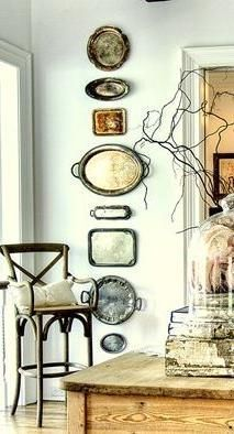 thrift store finds: silver serving trays wall art More
