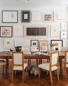 Nice chairs, black and white gallery wall. Would have been great with a large chandelier hanging low over the table