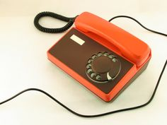 Vintage orange and brown rotary telephone Tesla