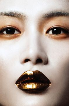 She's making it pop this fall with golden lips and eyeshadow.