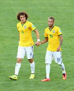 Neymar Photos Photos - David Luiz (L) and Neymar of Brazil celebrate after defeating Chile in a penalty shootout during the 2014 FIFA World Cup Brazil round of 16 match between Brazil and Chile at Estadio Mineirao on June 28, 2014 in Belo Horizonte, Brazil. - Brazil v Chile: Round of 16 - 2014 FIFA World Cup Brazil