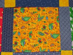 Detail of quilt using Shweshwe and bright prints.
