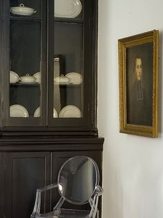 Kinda obsessed with this. Oil portrait + black cabinet + white china + Louis Ghost Chair (baba's painting)
