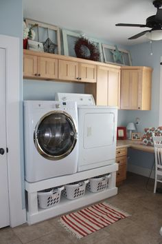 Washing Machine Stand with basket storage. I like the set up but what is going on with the washer/dryer set?