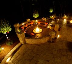 Landscape Lighting combined with hardscapes, patio, firepit, seatwalls, and columns to create beautiful outdoor lighting.