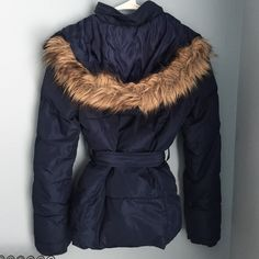 Navy puffer jacket with fur hood Wish I didn't have to sell but it's too small for me. Has pockets, buttons, working zipper. Hood is detachable. Fur isn't real. Minor wear. Very flattering Aeropostale Jackets & Coats Puffers