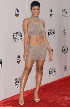 Scantily clad: Keke Palmer left little to the imagination in a mesh two-pieceNatalia Fedner dress