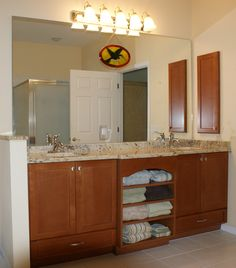 Amazing storage for your bathroom. Designed & installed by Royal Palm closet design & fine cabinetry. 239-768-2391