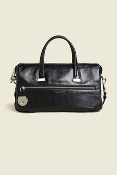 """Sophisticated with an edge, the Standard is a new family with a feminine appeal and vintage touch. Easily fitting all your essentials with a spacious interior and an additional shoulder strap just in case. Functional, versatile and not to mention, really cool.buDimensions/b/u13"""" L x 5"""" W x 8 1/2"""" H(34cm x 13cm x 22cm)buFeatures/b/u•Dish push lock•Exterior zip pocket•Two top handles and optional grommeted shoulder strap•Thick metal zipper pull with military feel•100% C..."""