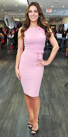 Last Night's Look: Love It or Leave It? | ELIZABETH HURLEY | Elizabeth continues to raise awareness for Breast Cancer, attending a Toronto event for the Esteé Lauder Companies in a pale-pink boatneck dress with a built-in bow-tie waist.